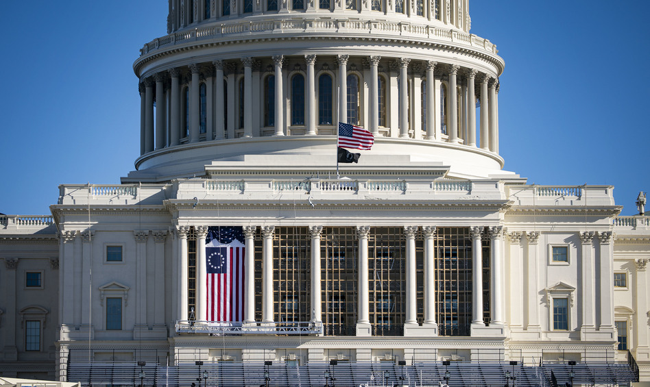 The American flag flies at half-staff on the west front of the U.S. Capitol on Saturday. On Monday, House Democrats introduced an impeachment resolution against President Trump over his role in last week's insurrection. (Al Drago/Getty Images)