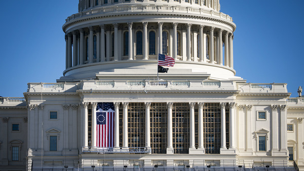 The American flag flies at half-staff on the West Front of the U.S. Capitol on Saturday. Monday, House Democrats introduced an impeachment resolution against President Trump for his role in last week