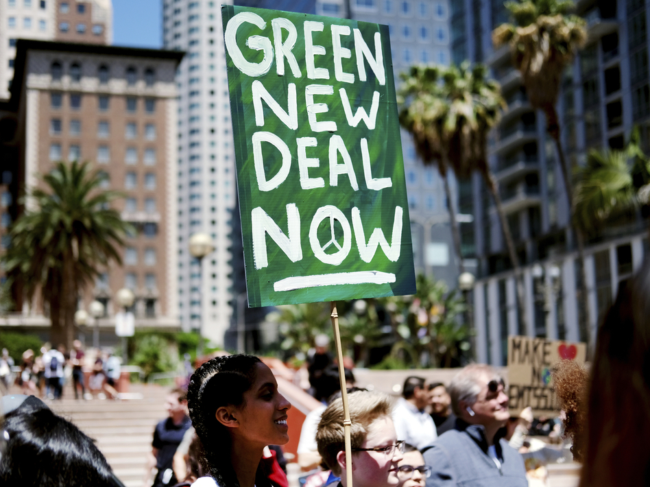 "Climate change activists holding signs join in on a rally supporting the ""Green New Deal"" in Pershing Square in downtown Los Angeles on Friday, May 24, 2019. (Richard Vogel/AP)"