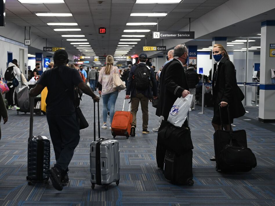 Dulles International Airport last month. The CDC will require all air passengers entering the U.S. to provide a negative COVID-19 test before boarding their flight. (Andrew Caballero-Reynolds/AFP via Getty Images)