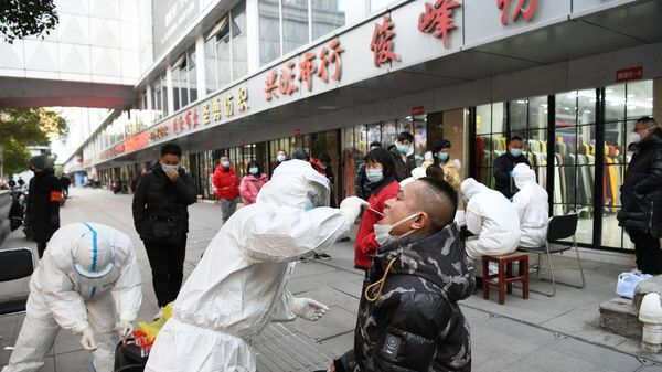 People queue up for nucleic acid testing at Hanzheng Street wholesale market on Tuesday, in Wuhan, Hubei Province of China.