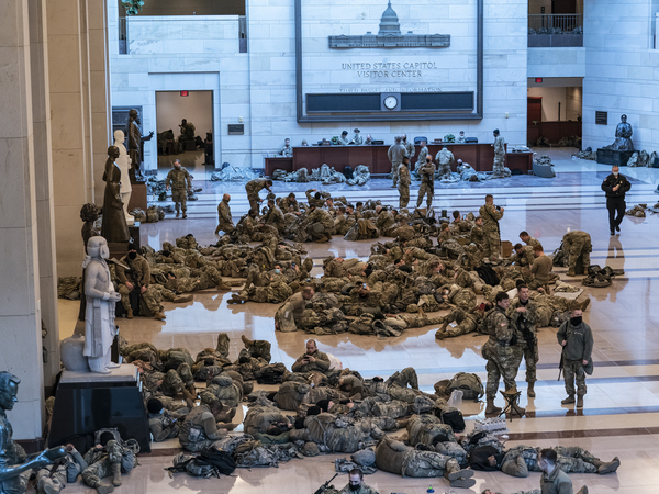 Hundreds of National Guard troops hold inside the Capitol Visitor's Center to reinforce security at the Capitol on Wednesday.