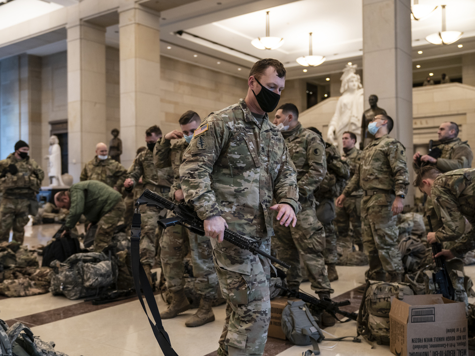 National Guard troops are inside the U.S. Capitol Visitor Center to reinforce security Wednesday at the Capitol in Washington. It comes a week after an insurrection at the Capitol. (J. Scott Applewhite/AP)
