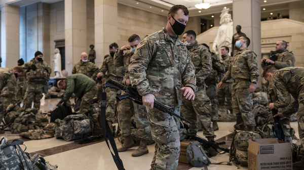 Hundreds of National Guard troops hold inside the Capitol Visitor