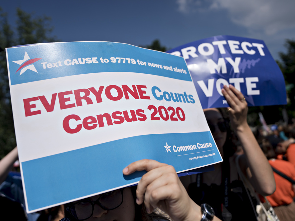 A demonstrator holds a sign about the U.S. census outside the Supreme Court in Washington, D.C., in 2019. The Census Bureau has stopped all work on President Trump's directive to produce a count of unauthorized immigrants that could be subtracted from a key set of census numbers, NPR has learned. (Andrew Harrer/Bloomberg via Getty Images)