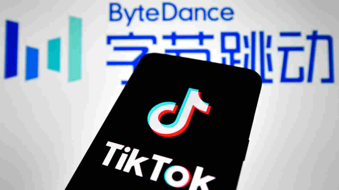 HAIKOU, HAINAN, CHINA - 2020/08/23: In this photo illustration, a TikTok logo seen displayed on a smartphone with a ByteDance logo picture in the background.
