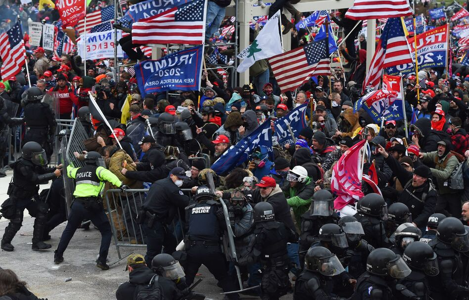 "When law enforcement officials failed to anticipate that pro-Trump supporters would devolve into a violent mob, they fell victim to what one expert calls ""the invisible obvious."" He said it was hard for authorities to see that people who looked like them could want to commit this kind of violence. (Roberto Schmidt/AFP via Getty Images)"