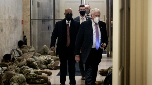 House Majority Leader Steny Hoyer, D-Md., passes some of the security forces who have been called up to protect the U.S. Capitol on Wednesday as the House impeachment proceedings begin.