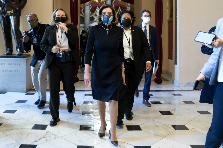 """House Speaker Nancy Pelosi, D-Calif., said that impeaching President Trump is """"a constitutional remedy that will ensure that the republic will be safe from this man."""" She's seen here walking to the House floor Wednesday ahead of the vote. (Stefani Reynolds/Getty Images)"""