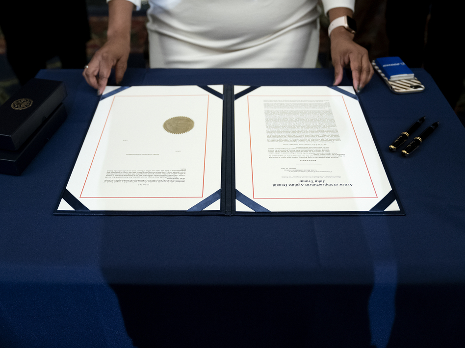The article of impeachment against President Trump was signed at the U.S. Capitolon Wednesday after it passed in the House. (Stefani Reynolds/Getty Images)