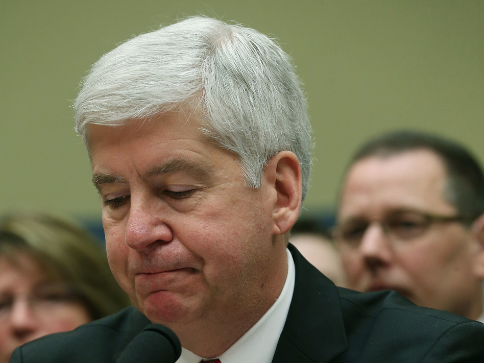 Now Former Michigan Gov. Rick Snyder, (R-MI), listens to Congressional members remarks during a House Oversight and Government Reform Committee hearing, about the Flint, Mich. water crisis in 2016. (Mark Wilson/Getty Images)