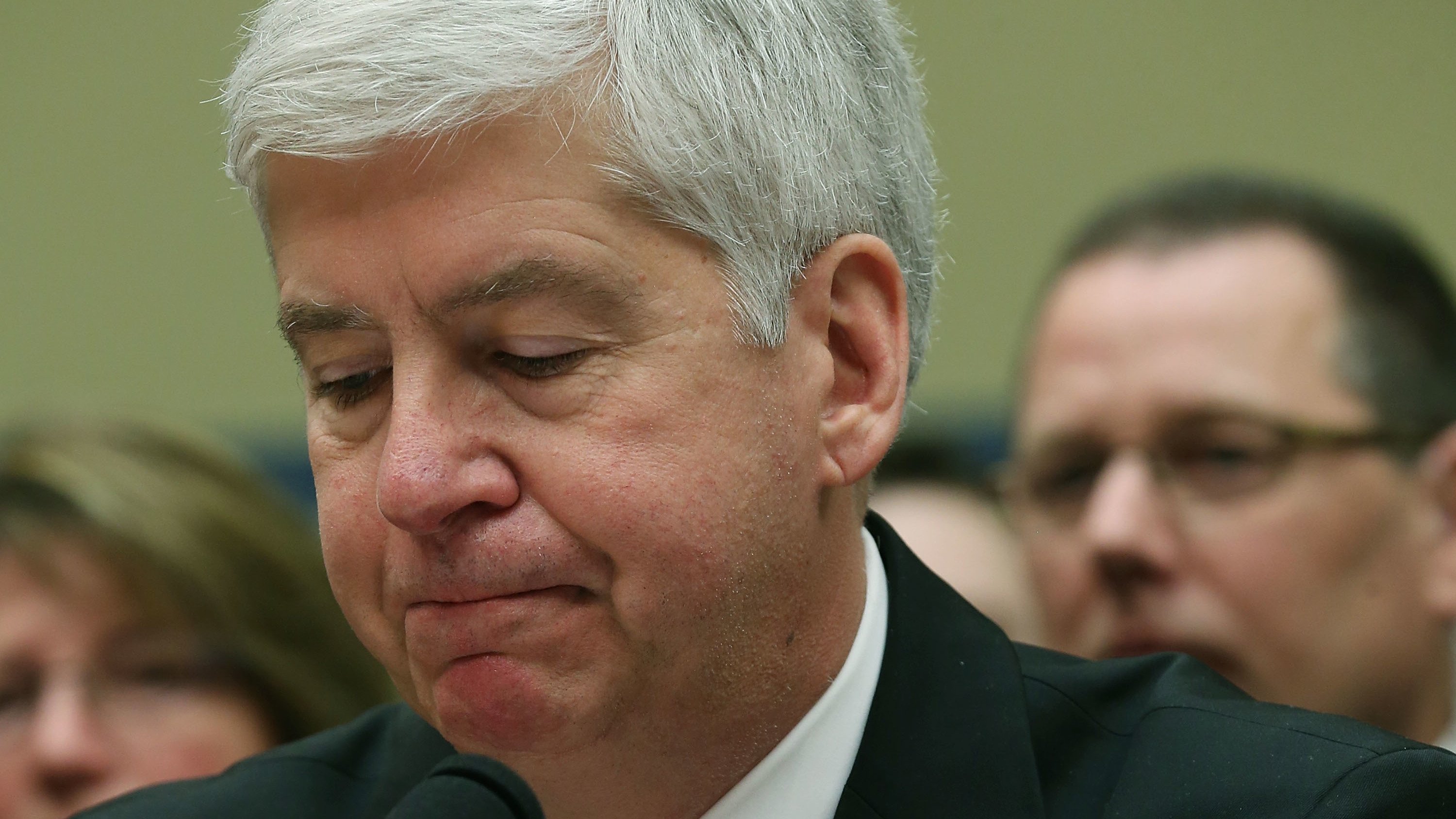 Now Former Michigan Gov. Rick Snyder, (R-MI), listens to Congressional members remarks during a House Oversight and Government Reform Committee hearing, about the Flint, Mich. water crisis in 2016.