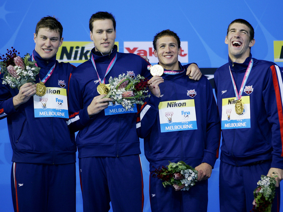 The U.S. men's 4x200-meter freestyle relay team members (from left) Peter Vanderkaay, Keller, Ryan Lochte and Michael Phelps celebrate after winning the gold medal at the World Swimming Championships in Melbourne, Australia, in 2007.