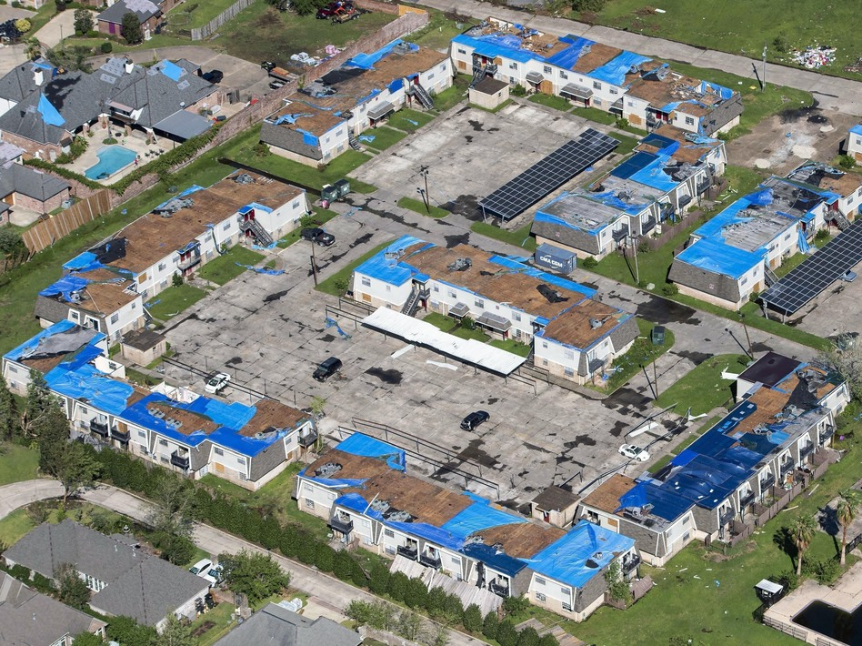Blue tarps cover houses with damaged roofs in Lake Charles, La., after Hurricane Delta hit the city in October 2020. (Bill Feig/AP)