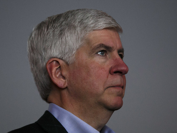 Former Gov. Rick Snyder, seen in 2017, was one of several current and former officials charged by state prosecutors for their role in the lead contamination of drinking water in Flint.