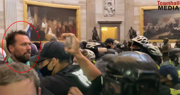 """A screenshot allegedly identifies Keller in the Rotunda during the U.S. Capitol insurrection. The FBI identified him in part because he was wearing a blue jacket with """"USA"""" on the back, court documents say."""