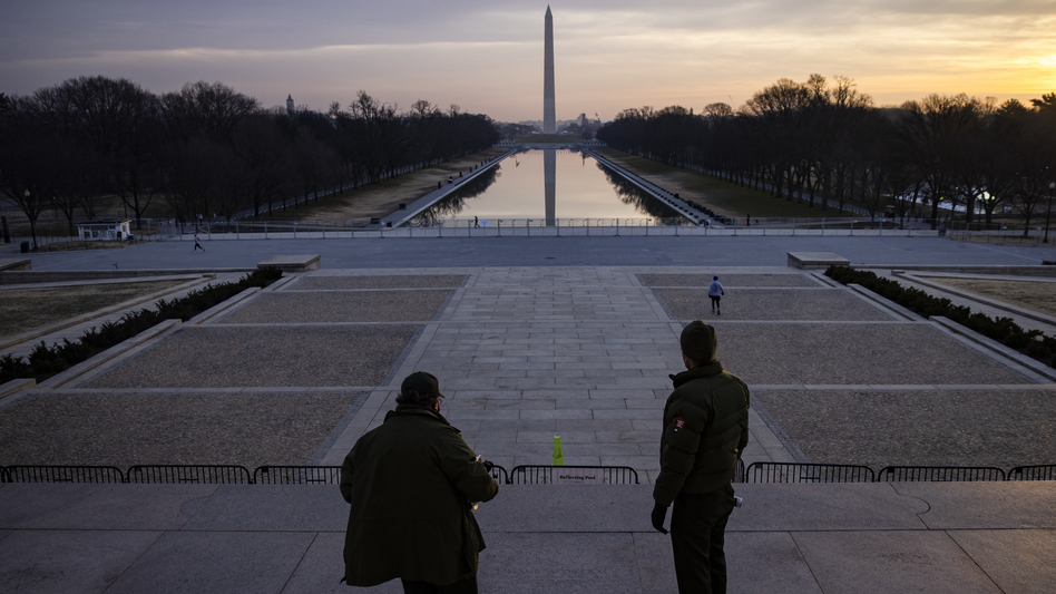 """U.S. park rangers look at the spot where the Rev. Martin Luther King Jr. gave his famous """"I Have a Dream"""" speech on the steps of the Lincoln Memorial in Washington, D.C., on Friday. Security threats have prompted officials to shut down the National Mall and much of downtown Washington, D.C. (Samuel Corum/Getty Images)"""