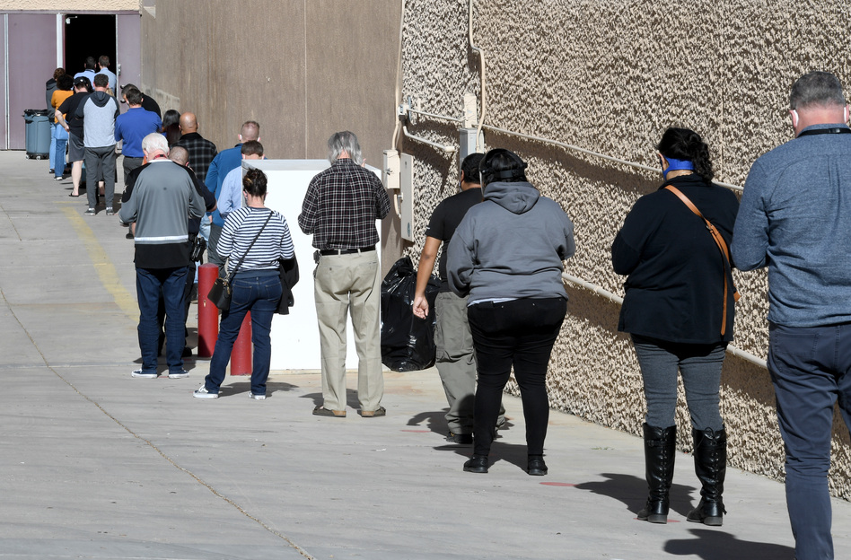 People line up on Thursday for the first day of Clark County's pilot COVID-19 vaccination program at Cashman Center in Las Vegas. (Ethan Miller/Getty Images)