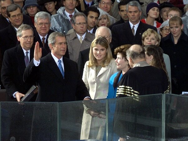 George W. Bush takes the oath of office from Chief Justice William Rehnquist to become the 43rd president on Jan. 20, 2001.