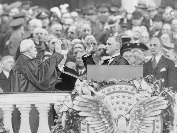 Franklin Delano Roosevelt takes the president's oath of office from Chief Justice Charles Evans Hughes on March 4, 1933.