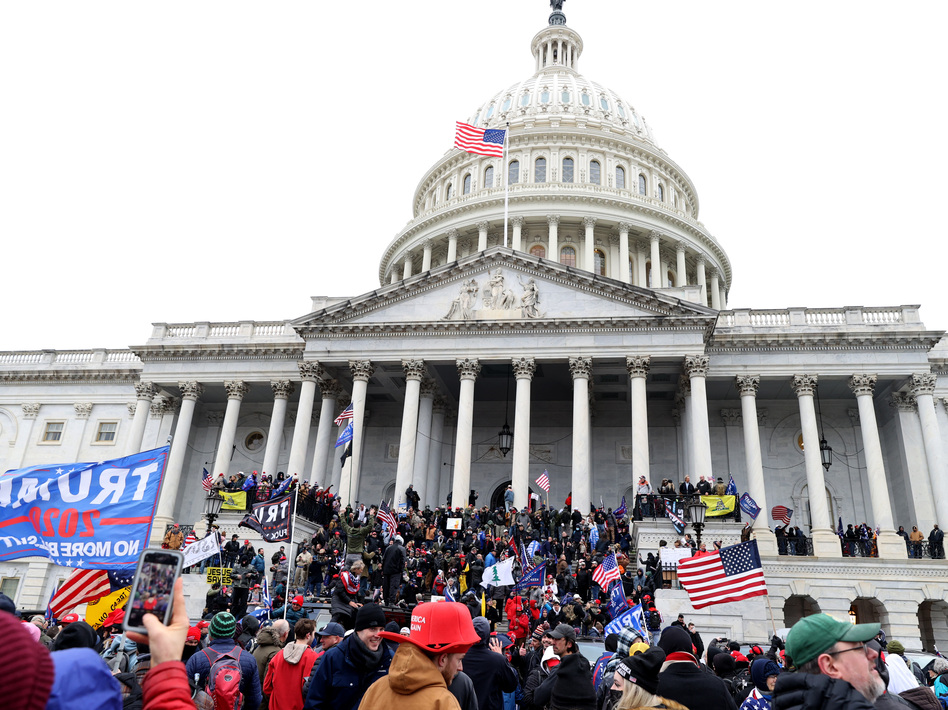 Pro-Trump protesters seeking to force Congress to overturn the election results swarm the U.S. Capitol on Jan. 6, two weeks before President-elect Joe Biden is scheduled to gives his inaugural address there. (Tasos Katopodis/Getty Images)