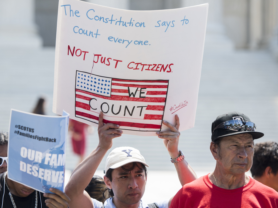 Protesters hold signs at a rally about the 2020 census in front of the U.S. Supreme Court in 2019. President-elect Joe Biden has revoked the Trump administration's policy of excluding unauthorized immigrants from population numbers used to reallocate congressional seats and Electoral College votes. (Bill Clark/CQ Roll Call via Getty Images)