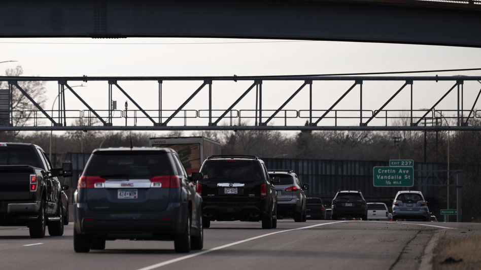 Vehicles drive on highway I-94 in St. Paul, Minn., on Nov. 7, 2020. A recent report from the International Energy Agency said emissions fell across most parts of the economy, with one notable exception: SUVs. (Stephen Maturen/Getty Images)