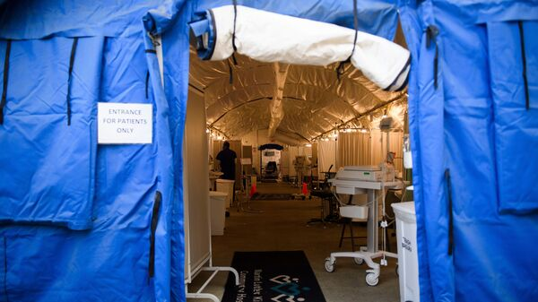 A field hospital tent for suspected COVID-19 patient triage was set up outside the emergency department of Martin Luther King Jr. Community Hospital in Los Angeles, California. A surge in deaths has prompted the county to lift environmental limits on the number of cremations that can be performed each month.