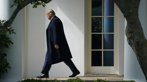 President Trump exits the Oval Office and walks to the South Lawn of the White House on Oct. 1. As he leaves the White House for the final time, Trump has rescinded rules prohibiting members of his administration from lobbying agencies where they worked for five years.