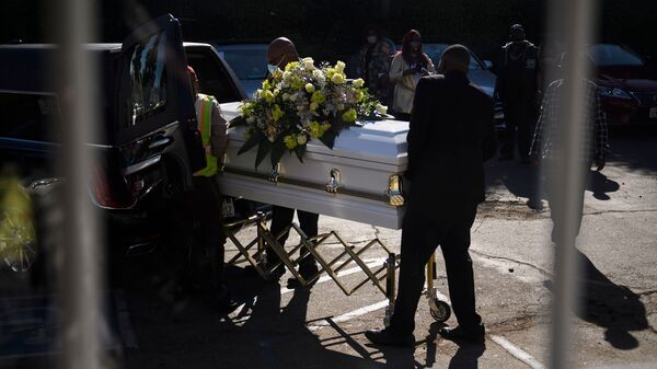 A casket is loaded into a hearse at the Boyd Funeral Home as burials at cemeteries are delayed to the surge of COVID-19 deaths on Jan. 14, 2021 in Los Angeles.