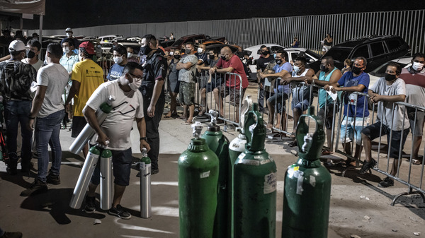 Workers check oxygen tanks at a hospital in Manaus, Brazil. Severe oxygen shortages as a second coronavirus wave is surging have prompted local authorities to airlift patients to other parts of Brazil.