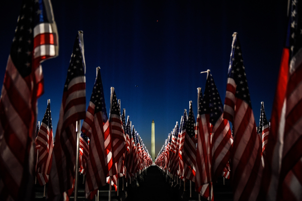 The Washington Monument is surrounded by American flags on the National Mall.