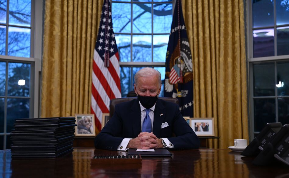 President Biden sits in the Oval Office at the White House after being sworn in as the 46th president of the United States on Wednesday. (Jim Watson/AFP via Getty Images)