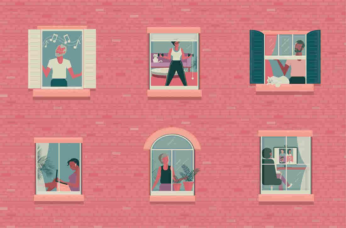 People seen through a windows inside their home.