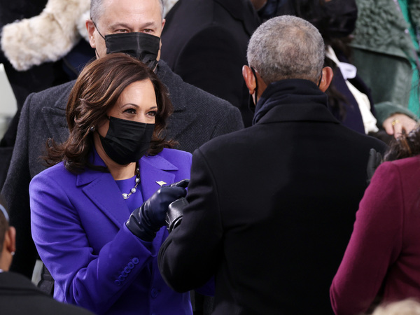 Harris and her husband Doug Emhoff greet former U.S. President Barack Obama as they arrive to the inauguration.