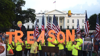 Members of Virginia's Herndon-Reston Indivisible group take part in a protest in front of the White House on Aug. 6, 2018. With former President Donald Trump out of office, progressive groups are turning their focus.