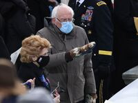 Sen. Bernie Sanders, I-Vt., arrives for Joe Biden's inauguration sporting mittens made from repurposed wool that were gifted to him by Jen Ellis, a teacher in Vermont.