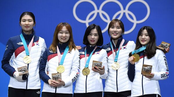 South Korean gold medalist Shim Suk-hee (far left), shown with her relay teammates during the 2018 Winter Olympics in Pyeongchang, South Korea, accused her former coach of repeated sexual assault.