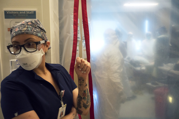 Maria Arechiga, an ICU charge nurse, monitors the progress of two COVID-19 patients in the intensive care unit of Martin Luther King Jr. Community Hospital in Los Angeles.