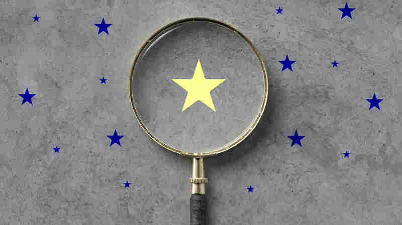 magnifying glass with a yellow star mark as symbol for finding a solution on concrete background - 3d illustration