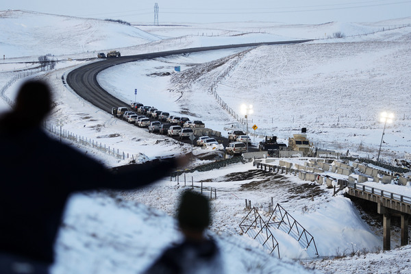 Vehicles line a road near a blocked bridge next to the Oceti Sakowin camp where protesters gathered in Cannon Ball, N.D. Much of the Dakota Access pipeline project controversy has been over a small portion running under the Missouri River. The Standing Rock Sioux tribe, whose reservation lies just downstream, worry that a leak could contaminate their drinking water and sacred lands.