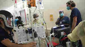 'Battlefield Medicine' In Los Angeles ICU As Biden Launches 'Wartime Effort'