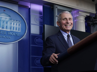 """Dr. Anthony Fauci laughs while speaking at a White House briefing on Thursday. Fauci, President Biden's chief medical adviser on COVID-19, says he rejoiced when the new president declared that """"science and truth"""" would guide the nation's policies toward the pandemic."""