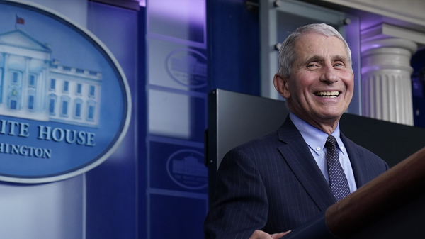 Dr. Anthony Fauci laughs while speaking at a White House briefing on Thursday. Fauci, President Biden