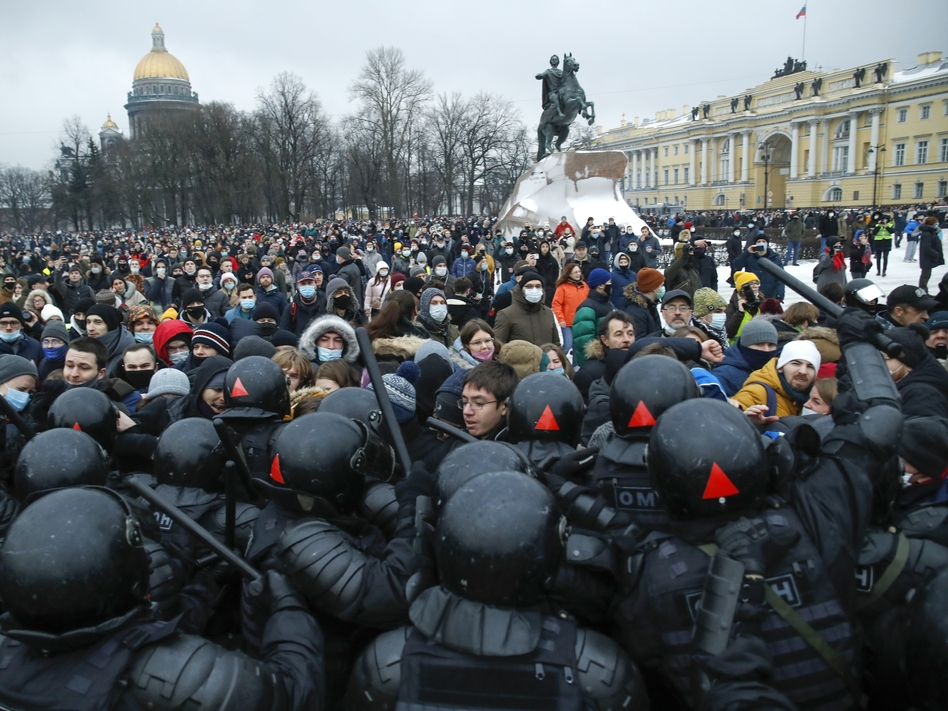 People clash with police Saturday during a protest in St. Petersburg, Russia, against the jailing of opposition leader Alexei Navalny. (Dmitri Lovetsky/AP)