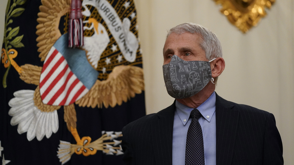 Dr. Anthony Fauci, director of the National Institute of Allergy and Infectious Diseases, arrives for an event with President Joe Biden on the coronavirus in the State Dinning Room of the White House on Thursday.