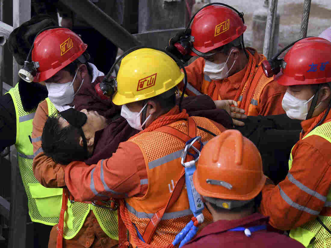Trapped Chinese miners rescued from gold mine after two weeks