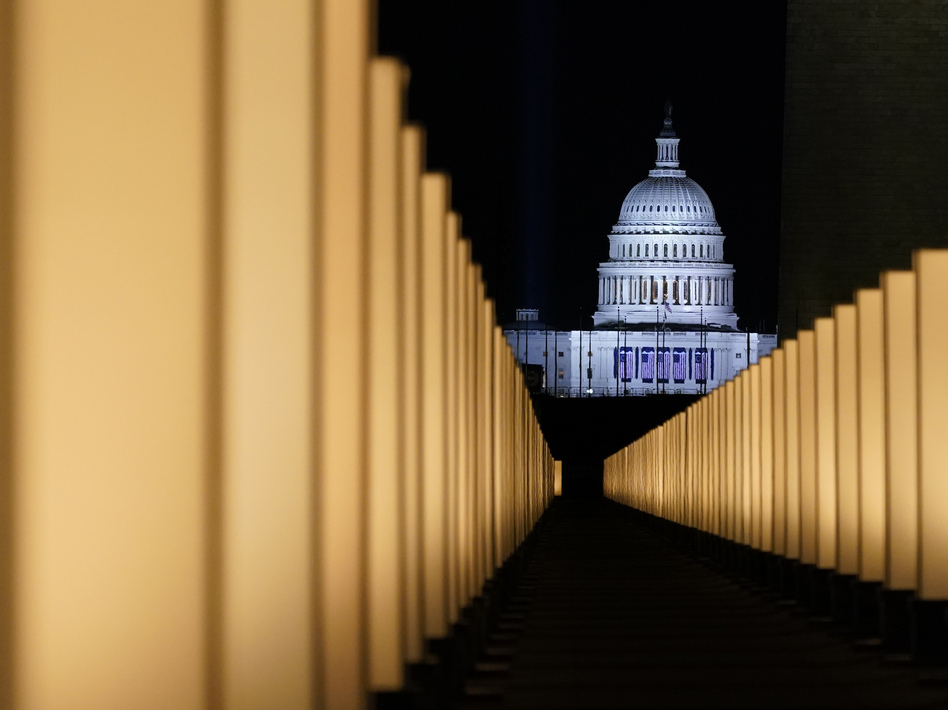 Lights placed as a memorial to COVID-19 victims surround the Lincoln Memorial Reflecting Pool on Jan. 19. Some economists believe deaths tied to alcohol use, drug use and suicides have risen during the pandemic as the isolation felt by many has taken an emotional toll. (Alex Brandon/AP)