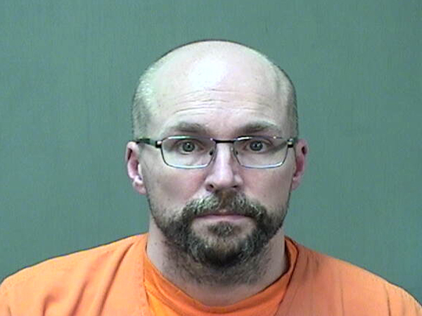 Steven Brandenburg at the Ozaukee County Sheriff's Office Monday, in Port Washington, Wis. Brandenburg agreed to plead guilty to two charges of of attempting to tamper with consumer products with reckless disregard for the risk that another person will be placed in danger of death or bodily injury, prosecutors say.