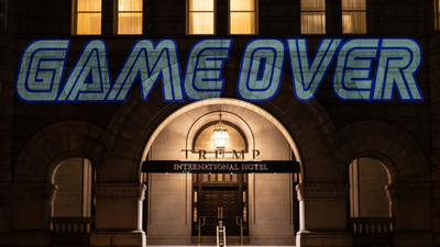 Robin Bell Spent Four Years Projecting Protest Messages On The Trump Hotel. Now What?